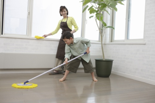 Son and mother cleaning up